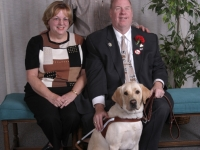 michael-africa-and-her-puppy-raisers-bill-and-peggy-sproul-before-graduation-of-class-690-december-13-2008
