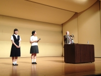 ence-miuseum-auditoriumhigh-school-girls-mike-and-yoshie-a-bit-on-stage-after-afternoon-speech