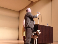 ence-museum-auditorium-mike-holding-microphone-and-speaking-july-17-2012